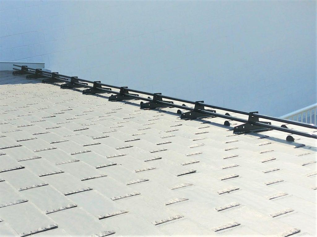 Snow guards for slate roofs